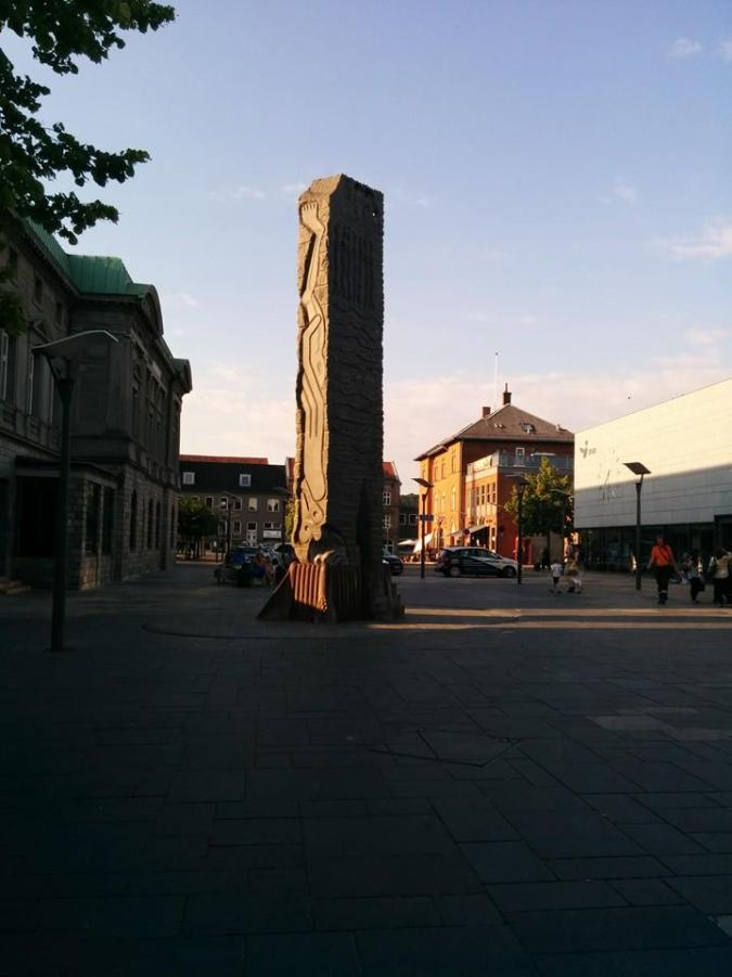 8.5-meter granite sculpture featuring biblical relief motifs created by Danish artist Bjørn Nørgaard